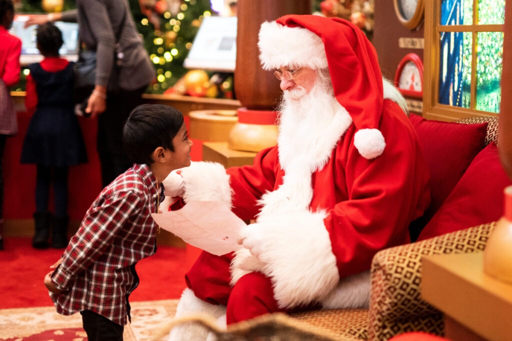 young boy meeting Santa
