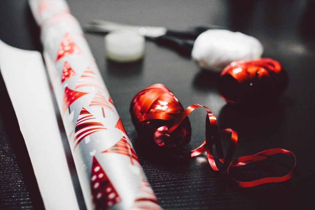 gift wrapping paper, scissors, and ribbon